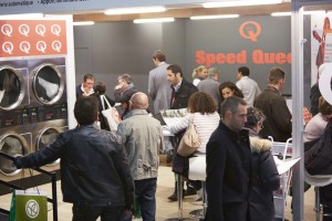 Visitors to the Speed Queen expo-franchise stand in Paris 1