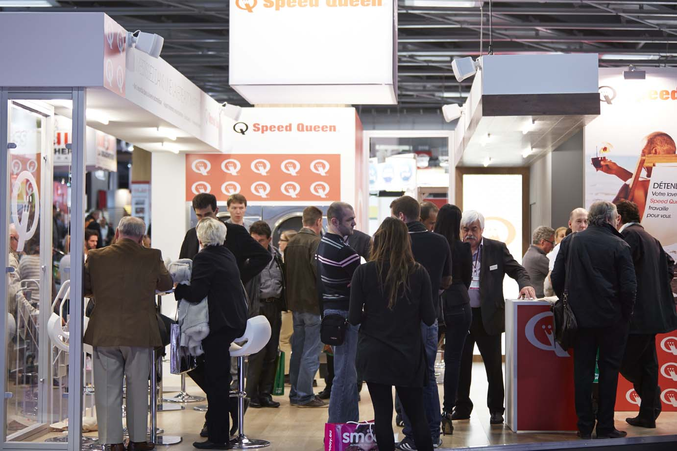 Visiteurs au stand Speed Queen expo franchise Paris 2